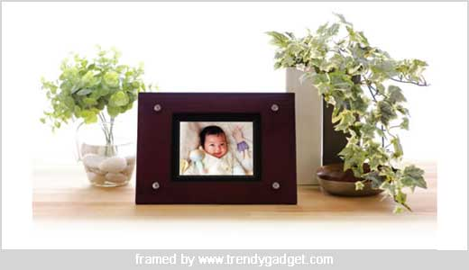 The new Iriver Siren Digital Photo Frame DF150 will be available in Japan early August 2007. The frame is made of Mahogany and has classic look, see picture, do you agree with me? The DF150 comes with 5.6-inch QVGA screen at 320×240 resolutions, 512MB of internal memory, and equipped with […]