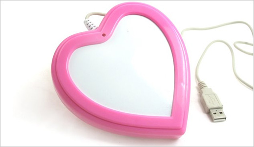 This USB Cup Warmer will keep your coffer warm while you're busy in front of your laptop. The heart-shape and pink color is designed for your Valentine's Day whether you're a boy or girl. Available from Gizmine.com for $13, this device is blah.. Read