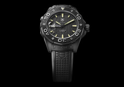 """Expected to be available in Setember, 2010, the Aquaracer 500M Calibre 5 """"Full Black"""" comes with a black rubber strap that has a solid titanium clasp with safety push buttons. Designed for divers, the watch is still able to run up to 500 metres under water. It houses a TAG […]"""