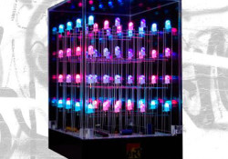 Available from hi-tecart.com for $100, the LED Cube is designed to entertain you who loves a mesmerizing light display. Features: 7.5vlt Power Supply, Acrylic Cube, and 64 LED's in a 4x4x4 display. It's more art than function, see video demo below to know the LED in action.