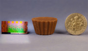 Photo-of-2nd-Generation-Intel-Core-Processor-as-Compared-to-Reese's-Mini-Peanut-Butter-Cup